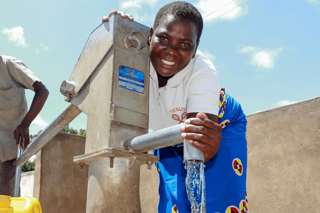 Enelesi standing by water tap