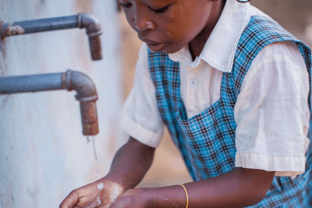 Child washing her hands.