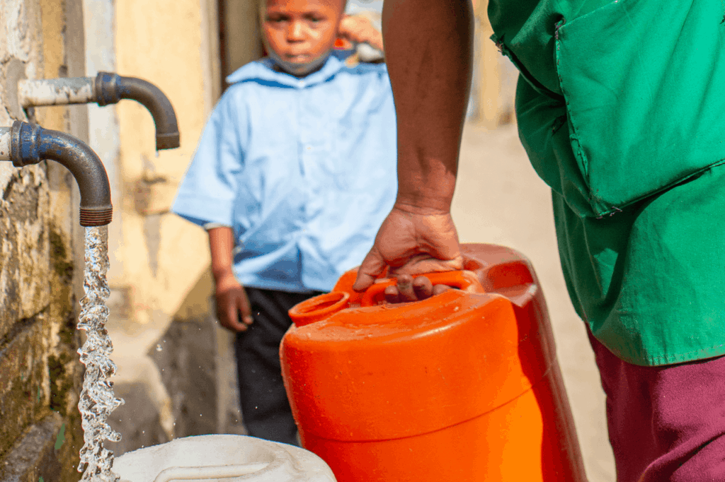 Woman collecting water.