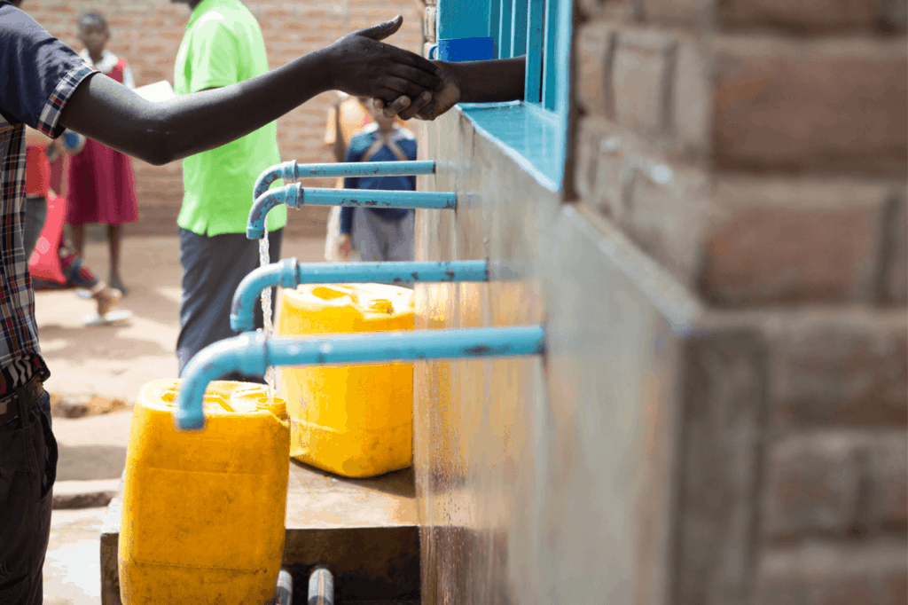 Person purchasing water from a community vendor