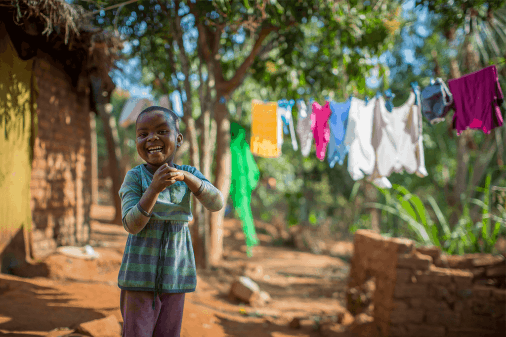 Little boy clapping his hands together in Rwanda