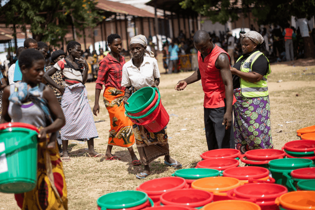 People queueing for clean water after Cyclone Idai